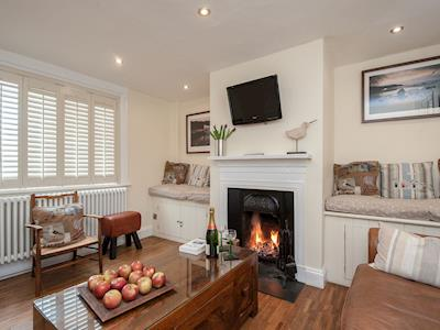 Cosy living room with open fire & wooden floor | Pebble Cottage, Aldeburgh