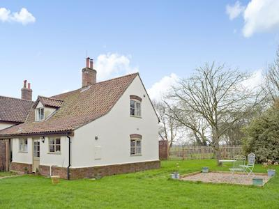 Exterior with large garden & seating area | Waveney Lodge Cottage, Toft Monks, near Beccles