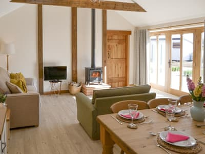 Stylish open-plan living space with French doors to patio area | Bert's Barn - Lyndhurst Farm Holiday Barns, Beighton, near Acle