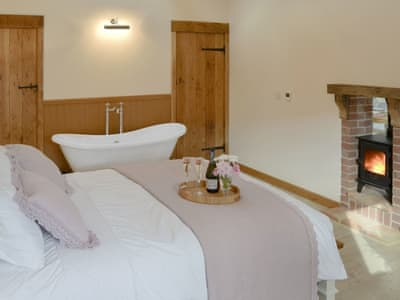 Romantic bedroom with free standing bath | Rabbit's Rest - Lyndhurst Farm Holiday Barns, Beighton, near Acle