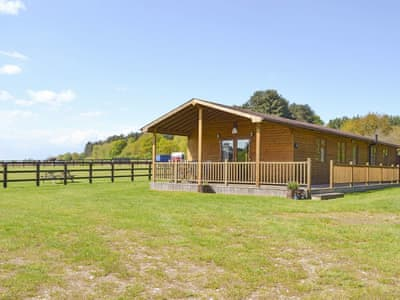 Attractive timber-built holiday home | The Log Cabin, West Stow, near Bury St Edmunds