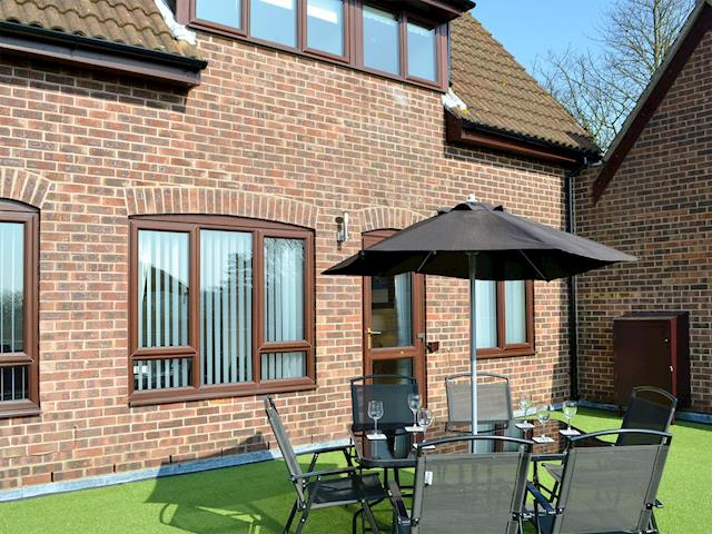 Exterior with siting out area | Villa 55, Cromer