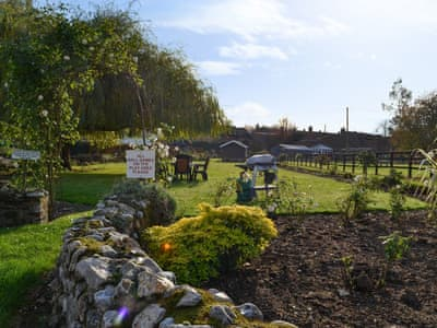 Shared garden seating area | Moor Farm Stable Cottages, Foxley, near Fakenham