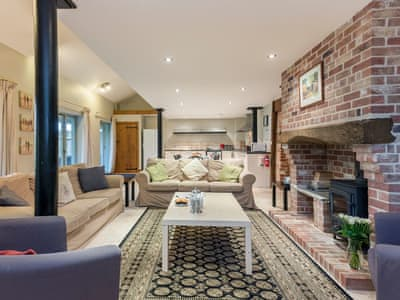 Cosy living area with wood burner | The Strawhouse - Manor Mews, Tattersett, near Fakenham