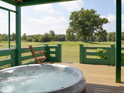 Private hot-tub sunken into the south facing decking | Norrells, Fritton, near Great Yarmouth