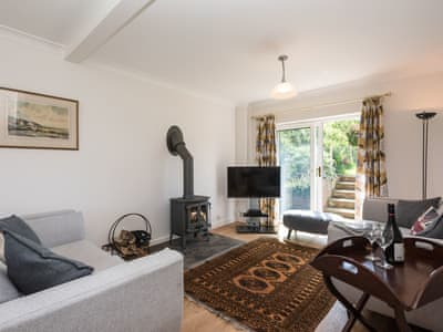 Living room with wood burner | Crinkum, Titchwell, near Hunstanton