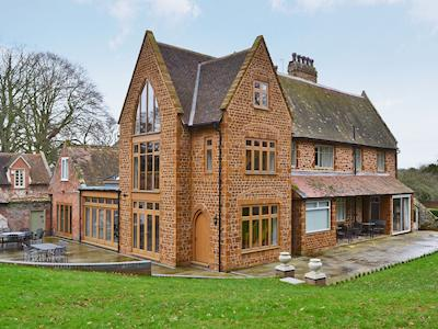 Exterior with shared furnished patio | The Pump House, Old Hunstanton, near Hunstanton