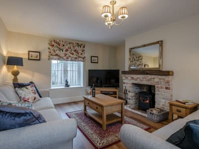 Cosy living room with wood burner | Wisteria House, Henstead, near Southwold