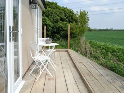 Seating area with views of the open countryside | The Nook, Clavering, near Saffron Waldon