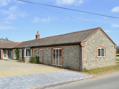 This excellent, single-storey barn conversion provides an ideal holiday home | Flint Barn - White House Farm Holiday Cottages, Knapton, near North Walsham