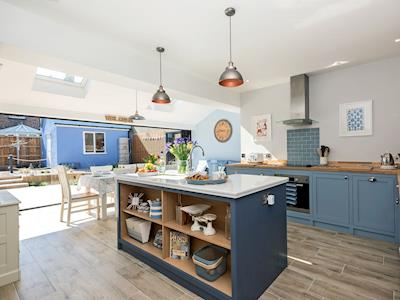 Light and airy kitchen/dining room leading to garden | Ascot Villa, Sheringham