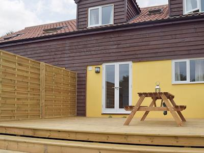 Attractive holiday home with outdoor furniture on decking | Walnut Tree Cottage, Wetherden, near Stowmarket