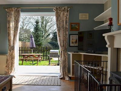 Patio doors from lounge lead to rear garden | Hawthorn House, Warham, near Wells-next-the-sea