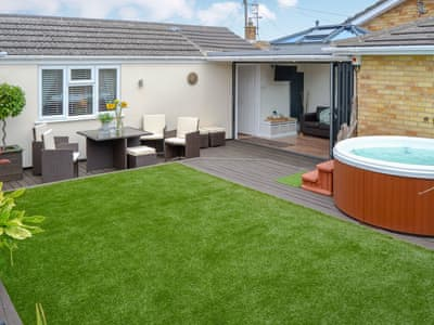 Delightful enclosed garden with private hot tub and sitting out area | Broadland Hideaway, Martham, near Great Yarmouth