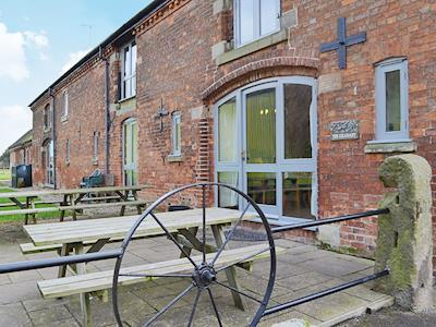 There is a spacious outdoor eating area with a barbecue | The Granary, Somersal Herbert, Ashbourne