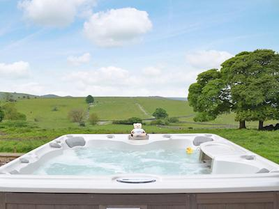 Relaxing hot tub with stunning countryside views | Whitehouse Farm Barn, Heathcote, near Hartington