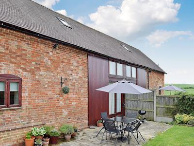 Exterior with sitting out area | Woodend Cottage, Abbots Lench, near Evesham