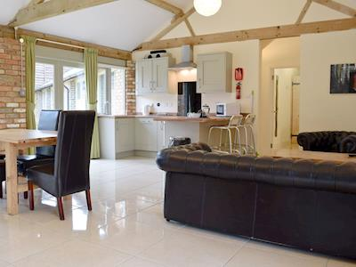 Fantastic living/dining room/kitchen with beams and tiled floor | Otters Holt - Tove Valley Farm Cottages, Heathencote, near Towcester