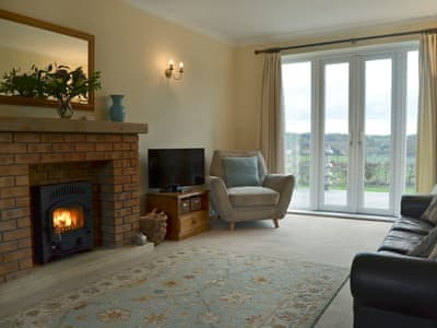Tastefully furnished living room with cosy wood burner | Pennwood Farmhouse, Penn, near Wolverhampton