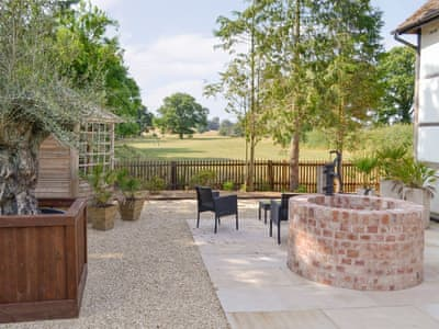 Patio area with tranquil rural views | Old Pyke Cottage - Old Pyke Cottages, Staunton, near Ledbury