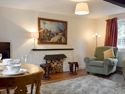 Charming living/ dining room | Rosecomb - Lapworth House Cottages, Lapworth, near Henley-in-Arden
