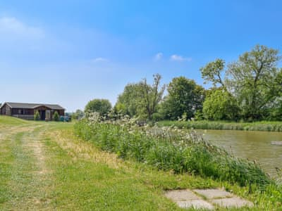 Holiday home set alongside a fishing lake | The Lodge, Bishops Itchington, near Southam