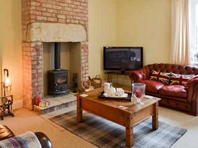 Cosy living room with wood burner | Anna's Cottage, East Burton, near Bamburgh