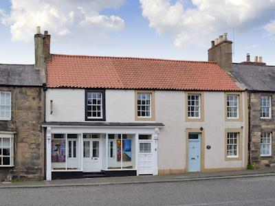 Exterior of the property situated on the high street | Lyon Cake House, Belford, near Bamburgh
