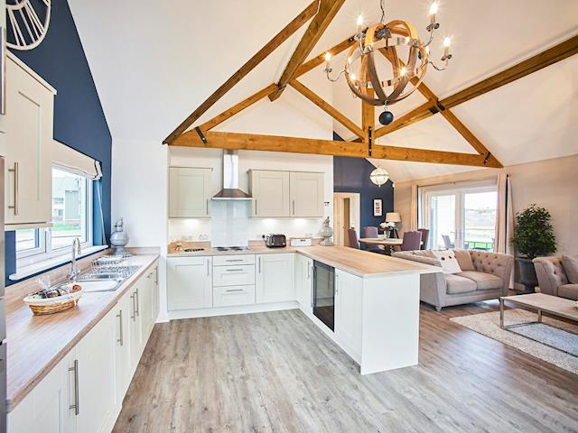 Well-equipped kitchen within an open-plan living area | Carmel, Beadnell, near Seahouses