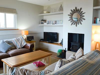 Relaxing living room with cosy wood burner | Gullsway, Beadnell