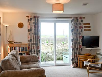 Living room with patio doors | The Neuk, Beadnell