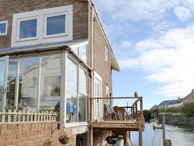 Attractive waterside holiday home | Water's Edge Holiday Home, Beadnell