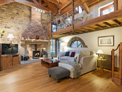 Impressive living room with vaulted ceiling and inglenook fireplace | Stodowa, Crook, near Durham