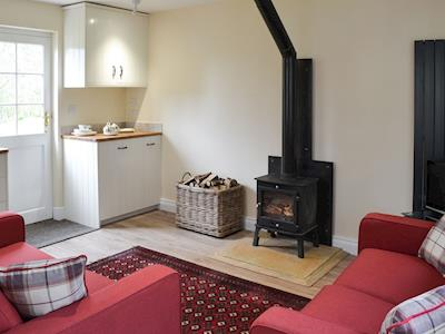 Living space with wood burning stove | Holly Cottage, Longhoughton, near Alnwick