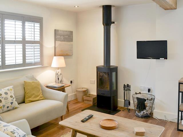 Stylishly, furnished open plan living space with wood burner | Shoreline Apartment, Craster, near Alnwick