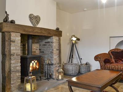 Inviting living area with wood burner | John Lively Cottage, Durham