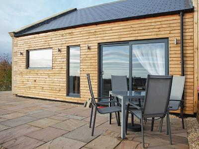 Patio area of timber-clad property with private outdoor seating area | Number 3 - The Old Stables, Knitsley, near Lanchester