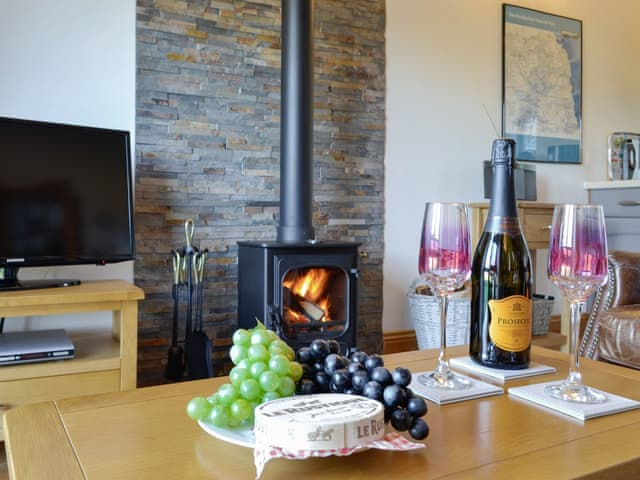 Inviting living area with wood burner | Stanegate Cottage, Greenhead, near Haltwhistle