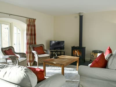 Spacious and light living room with wood burner | Mill House, Fourstones, near Hexham