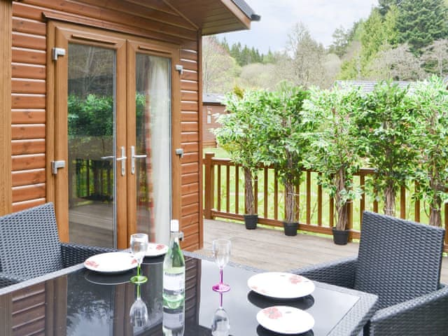 Attractive lodge with decked terrace | Puffin Cottage - Border Forest Cottages, Cottonshopeburnfoot, near Otterburn
