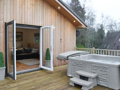 Detached holiday lodge with private hot tub for six guests | The Woodside Lodge, Otterburn, near Bellingham