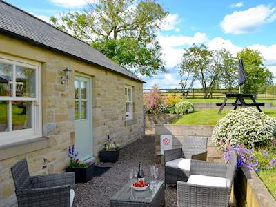 Charming holiday home with delightful sitting out area | Pear Tree Cottage, Longframlington, near Rothbury