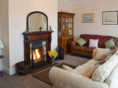 Homely living room with open fire | Todburn East, Todburn, near Rothbury