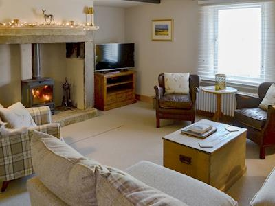 Beautifully presented cosy living room with a wood burner | West End Cottage, Whittingham, near Alnwick