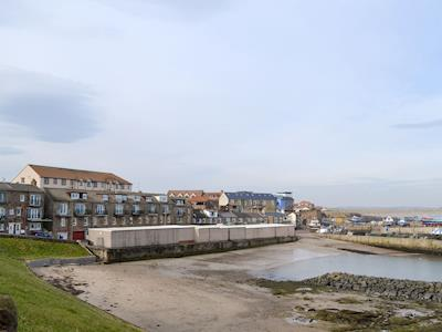 Impressive terraced property in a prime seafront position | Lobster Lodge, Seahouses, near Alnwick