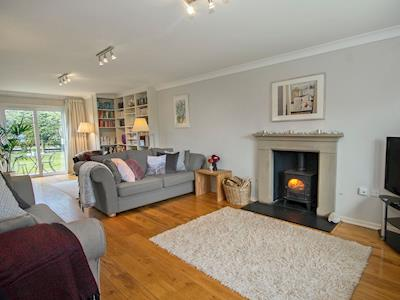 Beautifully presented living room with woodburner | Sunshine House, Seahouses