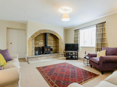 Large and airy living room with wood burner | Backstone Bank Farmhouse, Wolsingham, near Stanhope