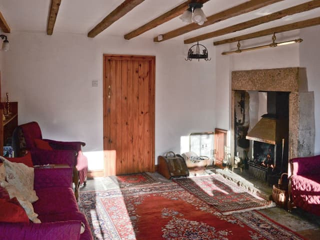 Living room with open fire | Cracket Cottage, Westgate, near Stanhope