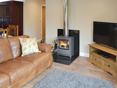 Cosy open plan living space with wood burner | River View, Warkworth, near Amble