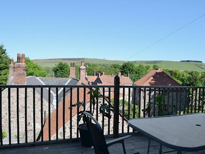 The balcony has chairs and a table at which to sit and admire the views of the Cheviot Hills | The Old Forge, Wooler
